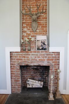 The sitting room is also home to one of the farmhouse's many showstoppers—this floor-to-ceiling brick fireplace that's beautiful in its rustic simplicity.    - ELLEDecor.com