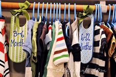 Closet divider idea. Made out of door hangers - most things don't fit over our clothes bar!