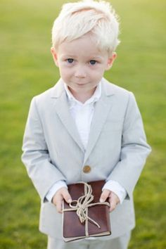 ring bearer holding a vintage novel