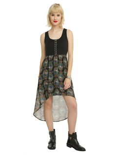 "<p>Feel like the fairest one of all in this dress inspired by Disney's <i>Snow White</i>. Black sleeveless dress with an Evil Queen stained glass designed chiffon hi-low skirt and hook 'n' eye detailed top.</p>  <ul> 	<li>34"" long from the front; 44"" long from the back</li> 	<li>Self: 87% polyester; 10% rayon; 3% spandex</li> 	<li>Contrast: 100% polyester</li> 	<li>Hand wash cold; dry flat</li> 	<li>Made in USA</li> </ul>"