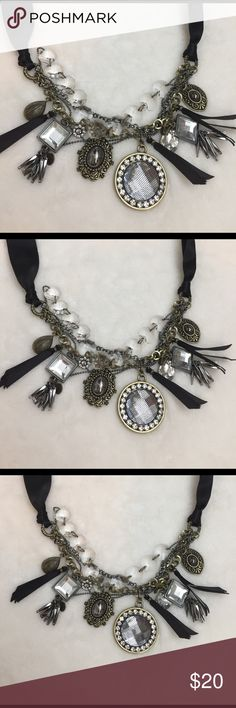 Black silver unique necklace This is such a wonderful piece, don't remember where I get it form but defiantly it's the cutest one. Has different crystals and charms and so special. Jewerly  Accessories
