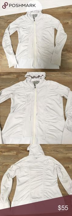 """Athleta """"Zippy Jacket"""" white with hood, Medium Athleta white zip-up with ruched design which makes it very slimming. Only flaw is the bottom of the sleeves by the hands are a little discolored since it's the side that faces down. still in very great shape. Medium. 86% polyester 14% spandex Athleta Jackets & Coats"""