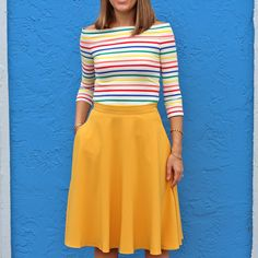 obsessed with the skirt color Color Me ModCloth - rainbow off shoulder and mustard skirt
