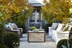 patio-deck-white-brick-herringbone-built-in-seating-outdoor chairs-gardenista