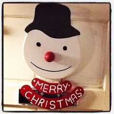 Snowman sign made from old wood.
