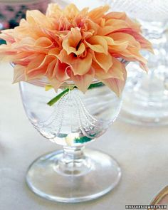 Simple Dahlia Arrangement  For this elegant centerpiece, we snipped a single dahlia bloom and set it in a pressed-glass sugar bowl. When setting a flower upon the rim of a cup or small bowl, be sure to leave an inch or so of stem attached, so the bloom can continue to drink.