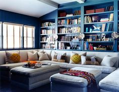 The colors in this Los Angeles home say casual and contemporary. See how versatile blue graces each room, from the living room sofas to the bold family room bookshelves.   - HouseBeautiful.com