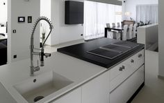Black and white kitchen - House F. by Martin Steininger
