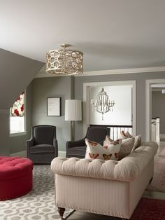 LOVE THIS SPACE for you ash, sofa may be too fem. for vito, but love the dark grey chairs and round tufted red ottoman. -perfection!!