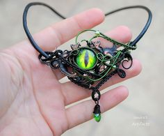 Green Dragon's eye on two winged gargoyles wire wrapped by Ianira