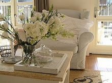 I love the gorgeous fresh flowers and oversized, cozy chair.