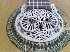 If You like it please vote on it. Owl shaped soundholecover, Instructables Wood Contest 2014.