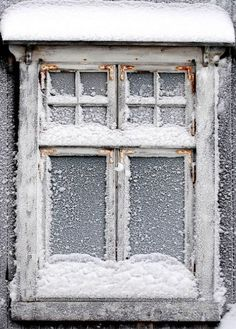 winter is coming... frosted, snowed window pane