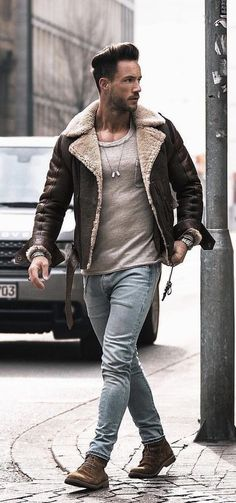 Men Clothing Nadine Din - fall combo idea with a shearling leather lambskin bomber jacket with a tan pocket t-shirt light wash denim watch brown suede boots Look Fashion, Winter Fashion, Fashion Outfits, Men's Outfits, Fashion Men, Fashion Styles, Denim Jacket Men, Leather Jacket, Mens Shearling Jacket
