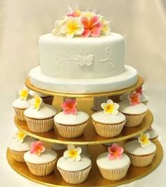 Frangipani wedding cake / cupcakes for Tropical Bali Wedding Celebration Themed Wedding Cakes, Wedding Cakes With Cupcakes, Cupcake Cakes, Pretty Cakes, Beautiful Cakes, Mini Tortillas, Luau Party Cakes, Frangipani Wedding, Cakes Plus