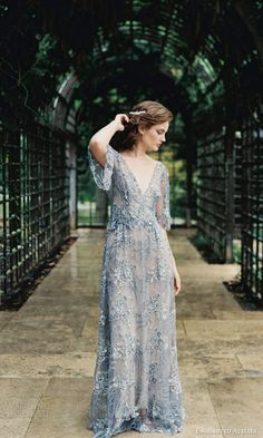 dusty blue embellished lace wedding gown with a V neckline
