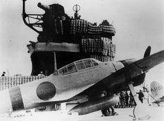 An A6M-2 Zero fighter aboard the Imperial Japanese Navy carrier Akagi during the Pearl Harbor attack mission.  Zeros were manufactured by Mitsubishi.