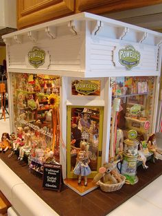 bakery. (jt- have interior pics of Powell's but not noticed this before - detail is amazing, obviously the children's favourite shop! Little girls made by Bonnie Justice. Pinned via Jenna Legg)