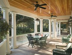 wood ceiling. This beautifully varnished wood is the perfect complement for this traditional porch. The floor itself is kept quiet, neutral and unassuming, as to not compete with the gorgeous ceiling.