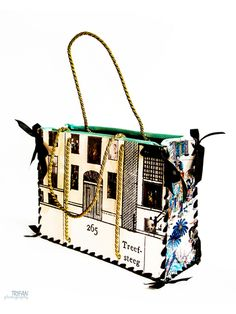 """Golden Age"" Tote designed by Scrapbags - A Dutch house made from laminated collage, look in the windows to see masterpieces from the world famous Rijks Museum. Based on a Dutch canal house, through the windows you can see treasures from Amsterdams world famous ""Rijks Museum"" mixed with a few modern images for a contemporary twist. It has a zip installed for extra security and interwoven handles that are stylish as well as strong. A classic we think."