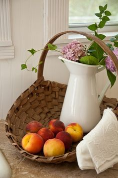 Pitcher, blooms & great use for your vintage basket find.