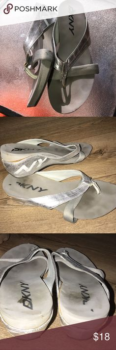 DKNY WEDGE FLIP FLOP Silver DKNY wedge flip-flops approximately a 3 inch wedge DKNY Shoes Sandals