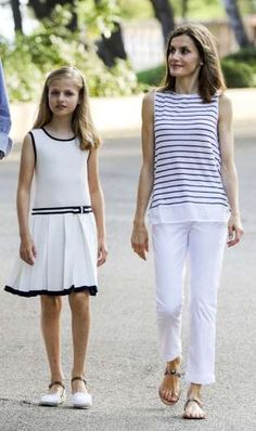 Queen Letizia does European casual well, too–here she is in summery white pants and a striped white ... - Provided by Town and Country