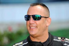 Tony Schumacher & Team racing at the Summer National's in the US. Army Nitro Dragster