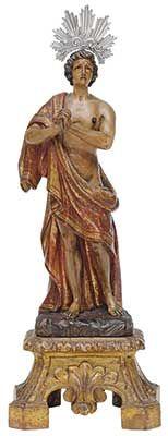Imagem portuguesa esculpida em madeira, policromada e dourada, representando São Manuel em sua clássica postura, despido. Base chanfrada. Acompanha resplendor. Séc. XIX. Alt. 32 cm. Base R$3.000,00 (ago/14). Não vendido.