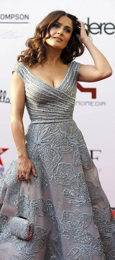 #SalmaHayek looks utterly exquisite in a plunging silver Gown