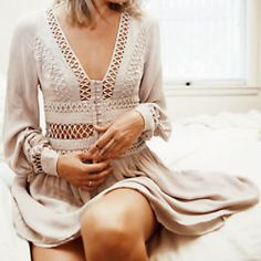 I Think I Love You Dress | Beautiful mini dress featuring sheer cutwork detail along the neckline and waist. Soft buttonup detail and hidden side zip closure make for an easy, effortless fit. Keyhole cutout at the back with button closure. Billowy, wide sleeves and flowy skirt make for a romantic silhouette. Lined.