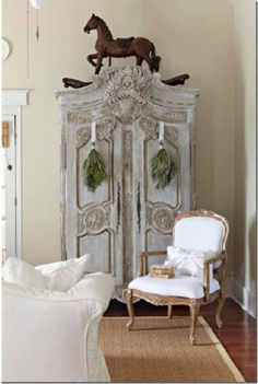 antique horse above armoire