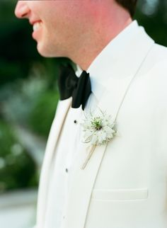 #boutonniere  Photography: Liz Banfield - lizbanfield.com  Read More: http://www.stylemepretty.com/southeast-weddings/2014/04/11/classic-southern-wedding-at-home/