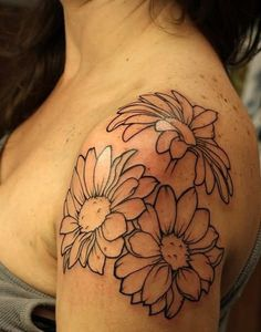 Among the flower tattoos, daisy designs have the most colorful patterns. You can find daisy tattoos of various colors by many people.