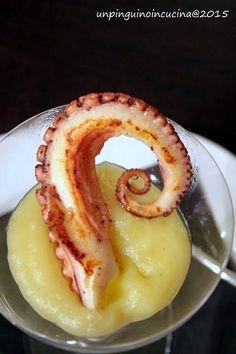 tentacolo di polpo arrosto servito su una crema di patate al tartufo