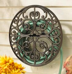 There are garden hose holder reels of all types from wall mount and free standing models to pots with lids and storage station carts on wheels for the most portability for watering lawns in the front and backyard flowers, plants and lawn. There's bronze, stone, stainless steel, plastic and other materials that these storing units are made of. Some of the best ones can be found at Lowes, Home Depot and even Ace Hardware. Source: www.homegardenexpress.com/garden-hose-holder/
