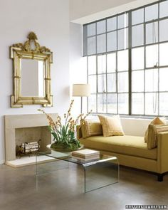 ornate gold leaf mirror over the modern stone fireplace! The chartreuse green settee & acrylic lucite coffee table! Really beautiful clean strong lines Small Space Living Room, My Living Room, Small Living, Living Room Decor, Living Spaces, City Living, Home Design, Interior Design, Clean Design