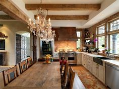 Aside from the chandeliers, this is my ideal kitchen! LOVE IT!