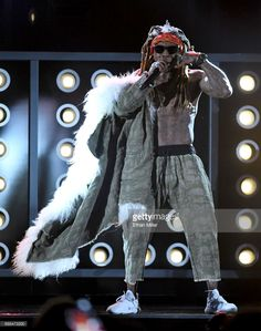 Rapper Lil' Wayne (C) performs during the 2017 Billboard Music Awards at T-Mobile Arena on May 21, 2017 in Las Vegas, Nevada.