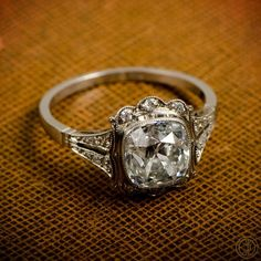Vintage Engagement Ring. A Beautiful Cushion Cut Diamond Engagement Ring, set in platinum with diamonds. BEAUTIFUL!