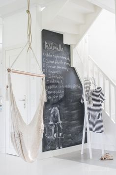 +great ideas for that crazy wall in stair case