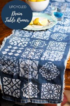 Cut the legs off your old jeans and turn them into a cool DIY denim table runner.  Use a Moroccan stencil to complete the Boho look.  #tablerunner #bohodiy #denim #moroccan