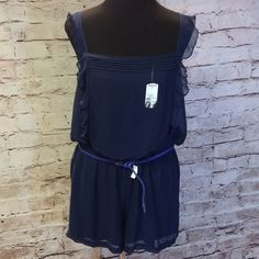 PRINCESS VERA WANG NAVY SHORTS ROMPER This is a junior XL Navy shorts romper with pretty ruffle detail and woven PU belt. Fully lined and easy care polyester material. Princess Vera Wang Shorts