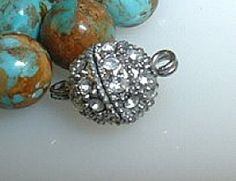 The crystals look like diamonds in this magnetic clasp!