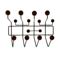 Made from a framework of coated steel wire with lacquered maple wood balls, this modern take on a classic hat rack gives you enough knobs and nodules for all your accessories. Appealing to the eye with...  Find the Ways to Hang Coat Rack, as seen in the Naturally Mid-Century Collection at http://dotandbo.com/collections/naturally-mid-century?utm_source=pinterest&utm_medium=organic&db_sku=DBI1006-WAL