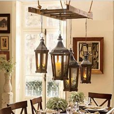 get this style, lantern chandelier http://www.theverbenacottage.com/item_417/Park-Hill-Metal-Lantern.htm