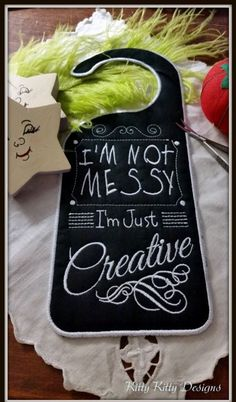 "many don't understand the Creative mind! But we can hang a tag on our craft rooms and sewing nooks to let them know everything is A-OK and ""Normal"" for you. Made in one hooping, ""Messy"" is the p Embroidery Supplies, Machine Embroidery Patterns, Letter Door Hangers, Sewing Nook, Wood Crafts, Diy Crafts, Chalkboard Designs, Chalkboard Paint, Space Crafts"
