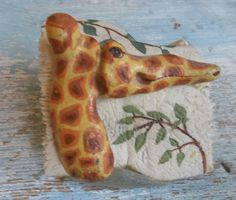 painted giraffe rock on bone & sea porcelain base