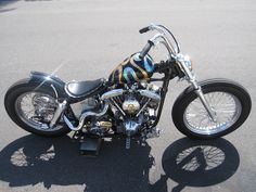 shovelhead swingarm custom with spool front wheel and ribbon paint job.