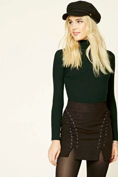A ribbed knit top featuring a turtleneck, long sleeves, and a fitted silhouette.
